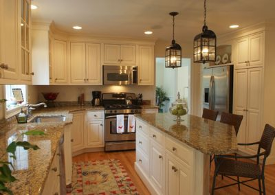 white-wooden-kitchen-cabinets-with-kitchen-layout-designs-also-kitchen-island-with-pendant-lamp-and-sink-kitchen-arrangement-pictures